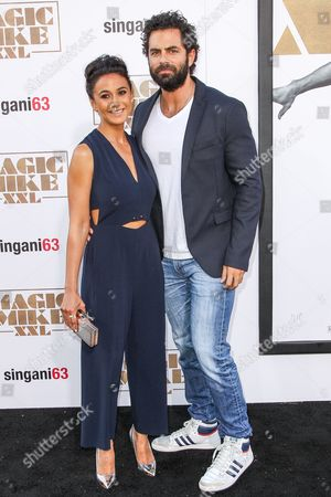 "Emmanuelle Chriqui, left, and Adrian Bellani arrive at the Los Angeles premiere of ""Magic Mike XXL"" at the TCL Chinese Theatre on"