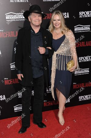 """Mickey Dolenz, left, and Donna Quinter arrive at the LA Premiere Of """"McFARLAND, USA"""", in Los Angeles"""