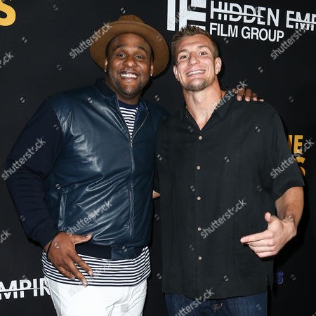 "Stock Image of Glen Davis, left, and Rob Gronkowski attend the LA Premiere of ""Meet the Blacks"" held at ArcLight Hollywood, in Los Angeles"