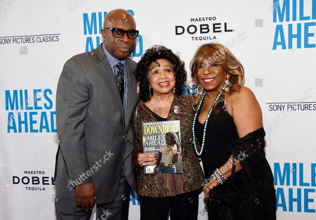 "Left to right, Vince Wilburn Jr., nephew of Miles Davis, Frances Davis, ex-wife of Miles Davis, and Cheryl Davis, daughter of Miles Davis, pose together at the premiere of the film ""Miles Ahead"" at the Writers Guild Theatre, in Beverly Hills, Calif"