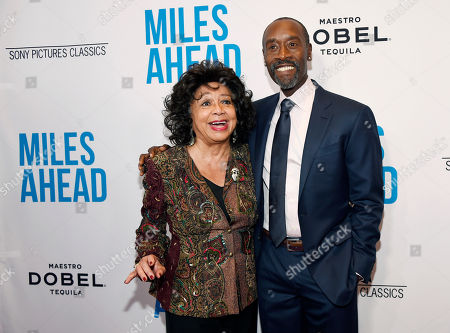 """Stock Photo of Don Cheadle, right, the star, director and co-screenwriter of """"Miles Ahead,"""" poses with Frances Davis, ex-wife of legendary jazz trumpeter Miles Davis, at the premiere of the film at the Writers Guild Theatre, in Beverly Hills, Calif"""