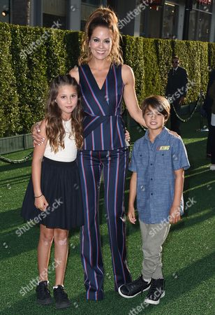 """Stock Picture of Brooke Burke-Charvet, center, and her children Heaven Rain Charvet, left, and Shaya Charvet arrive at the Los Angeles premiere of """"Pete's Dragon"""" at the El Capitan Theatre on"""