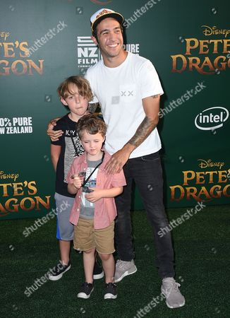 """Pete Wentz, from right, and his sons Saint Lazslo Wentz and Bronx Mowgli Wentz arrive at the Los Angeles premiere of """"Pete's Dragon"""" at the El Capitan Theatre on"""