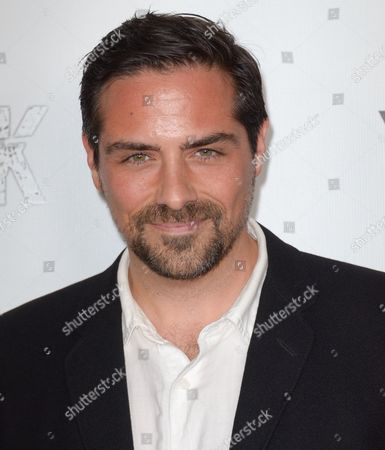 """Stock Photo of Brandon Pizzola arrives at the LA Premiere of """"Aftershock"""" at the Chinese 6 Theatres on in Los Angeles"""