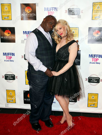 "Cathryn Michon, right, and Gary Anthony Williams pose together at the Muffin Top: A Love Story Premiere at LA LIVE, in Los Angeles. Muffin Top is a body image rom com made by women with the message: ""Love Yourself NOW, Not 5 LBS From Now"