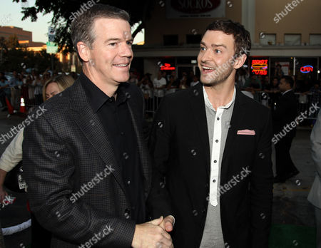 """Cast member Justin Timberlake, right, and director Robert Lorenz talk to each other at the premiere of """"Trouble With the Curve"""" at the Westwood Village Theater, in Los Angeles"""