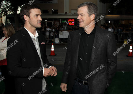 """Cast member Justin Timberlake, left, and director Robert Lorenz talk to each other at the premiere of """"Trouble With the Curve"""" at the Westwood Village Theater, in Los Angeles"""