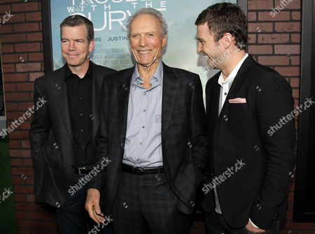 """Cast member Clint Eastwood, center, cast member Justin Timberlake, right, and director Robert Lorenz pose together at the premiere of """"Trouble With the Curve"""" at the Westwood Village Theater, in Los Angeles"""