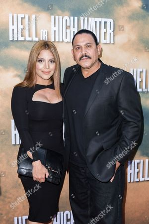 "Yadi Valerio Rivera, left, and Emilio Rivera arrive at the special screening of ""Hell or High Water"" at the Arclight Hollywood, in Los Angeles"