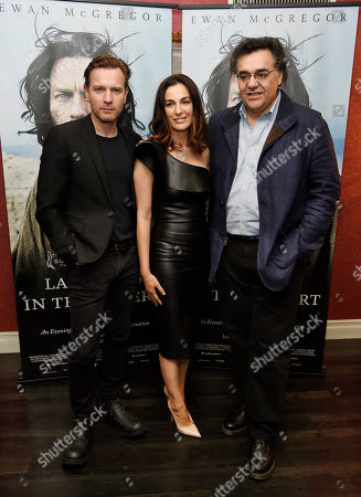 """Rodrigo Garcia, right, writer/director of """"Last Days in the Desert,"""" poses with cast members Ewan McGregor, left, and Ayelet Zurer at a special screening of the film at Laemmle's Royal Theatre, in Los Angeles"""