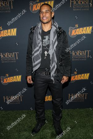 Stock Image of Actor Travis Winfrey arrives at 'The Hobbit: The Desolation Of Smaug Expansion Pack' launch party at Eveleigh on in West Hollywood, Calif