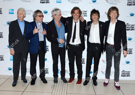 Charlie Watts, Bill Wyman, Keith Richards, Brett Morgan, Ronnie Wood, Mick Jagger of The Rolling Stones poses at London Film Festival American Express Gala The Rolling Stones - Crossfire Hurricane at Odeon West End on in London