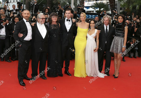From left, Tom Hardy, George Miller, Sandy Gore, Charlize Theron, Nicholas Hoult, Zoe Kravitz, Doug Mitchell and Courtney Eaton arrive for the screening of the film Mad Max: Fury Road at the 68th international film festival, Cannes, southern France