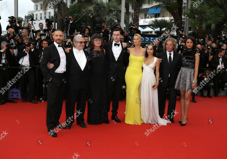 Tom Hardy, director George Miller, Margaret Sixel, Nicholas Hoult, Charlize Theron, Zoe Kravitz producer Doug Mitchell, Courtney Eaton, from left to right pose for photographers on the red carpet at the screening of the film Mad Max: Fury Road at the 68th international film festival, Cannes, southern France