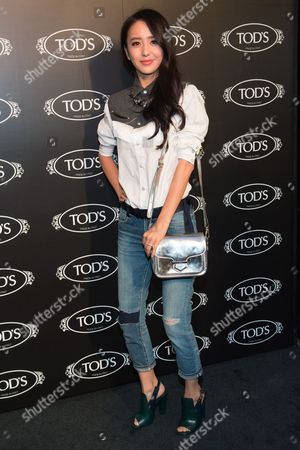 Tong Liya arrives at Tod's Boutique Re-Opening party, in New York