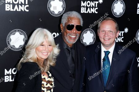 Director PR International and Cultural Affairs Montblanc Ingrid Roosen-Trinks, actor Morgan Freeman and CEO of Montblanc North America Jan Patrick Schmitz attend Montblanc de la Culture Arts Patronage Award honoring Quincy Jones at Chateau Marmont, in Los Angeles
