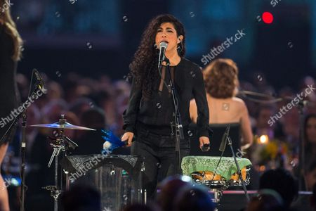 Mona Tavakoli, of Raining Jane, performs on stage at the MusiCares 2014 Person of the Year Tribute on in Los Angeles