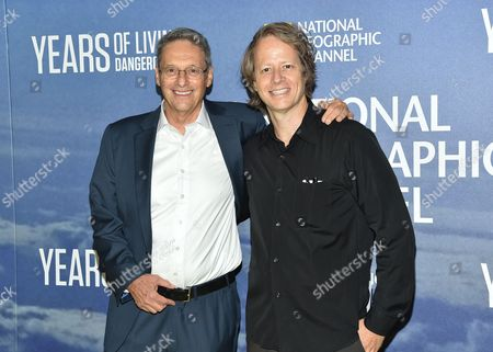 "Executive producers David Gelber, left, and Joel Bach attend the premiere of National Geographic Channel's, ""Years of Living Dangerously,"" at the American Museum of Natural History, in New York"