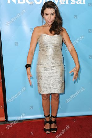 Kari Wuhrer attends the NBC 2014 Summer TCA held at the Beverly Hilton Hotel, in Beverly Hills, Calif