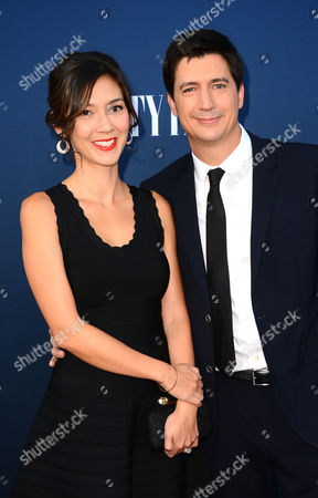 Erica Oyama, left, and Ken Marino arrive at NBC And Vanity Fair's 2014 - 2015 TV Season Event at Hyde Sunset Kitchen, in Los Angeles