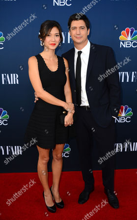 Erica Oyama and Ken Marino arrive at NBC And Vanity Fair's 2014 - 2015 TV Season Event at Hyde Sunset Kitchen on in Los Angeles