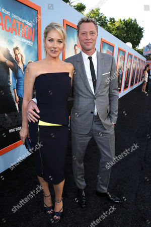 """Christina Appelgate and Martyn LeNoble seen at the New Line Cinema presents the Premiere of """"Vacation"""" held at Regency Village Theatre, in Westwood, Calif"""