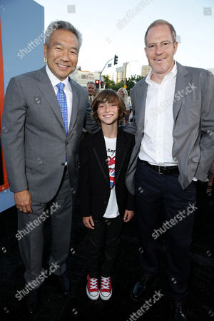 """Kevin Tsujihara, Chief Executive Officer of Warner Bros., Steele Stebbins and Toby Emmerich, President and COO, New Line Cinema seen at the New Line Cinema presents the Premiere of """"Vacation"""" held at Regency Village Theatre, in Westwood, Calif"""