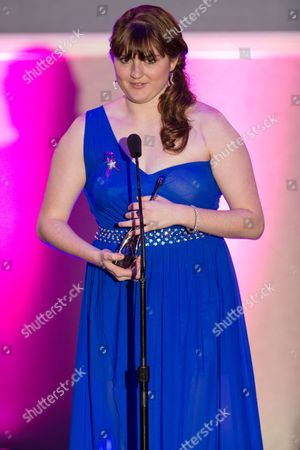 """Jennifer Miller accepts the award for Best Visual Effects for her film """"You're Never Alone"""" during the No Bull Teen Video Awards at the Westin LAX Hotel on in Los Angeles"""