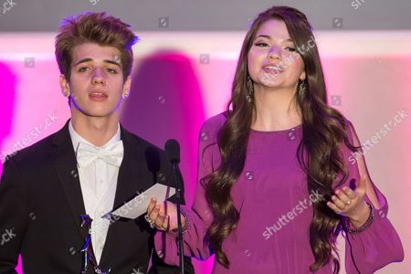 From left, actors Brandon Tyler Russell and Jadin Gould present the award for Best Community Involvement during the No Bull Teen Video Awards at the Westin LAX Hotel on in Los Angeles