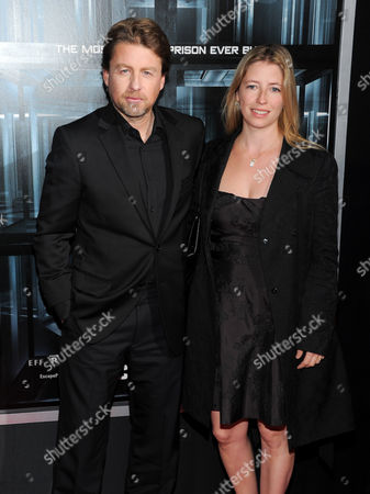 """Director Mikael Hafstrom and wife Kelly attend the premiere of """"Escape Plan"""" at the Regal E-Walk, in New York"""
