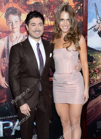 "Writer Jason Fuchs and actress Alexandra Siegel attend the premiere of ""Pan"" at the Ziegfeld Theatre, in New York"