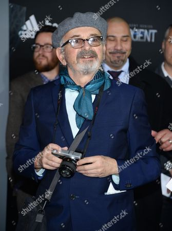 """Photographer Arthur Elgort attends the premiere of """"The Divergent Series: Insurgent"""" at the Ziegfeld Theatre, in New York"""
