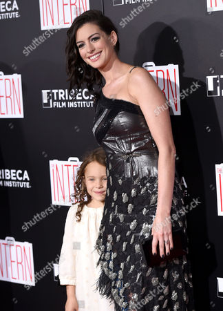 "JoJo Kushner, left, and Anne Hathaway attend the premiere of ""The Intern"" at the Ziegfeld Theatre, in New York"