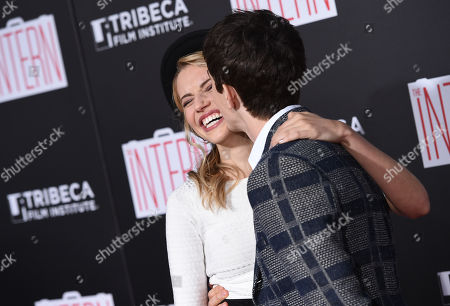 "Actors Wallis Currie-Wood, left, and boyfriend Alex Sharp attend the premiere of ""The Intern"" at the Ziegfeld Theatre, in New York"