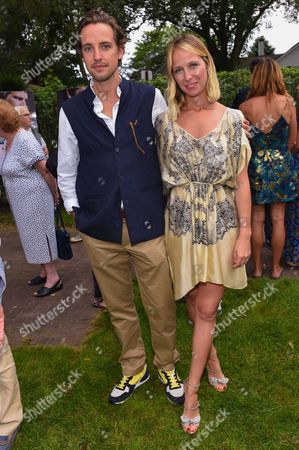 """Alexander Gilkes, left, and Misha Nonoo attend a special screening of """"99 Homes"""" at Guild Hall in East Hampton, in New York"""