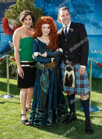 "Producer Katherine Sarafian, Character Merida and director Mark Andrews arrive at the ""Brave"" premiere at the Dolby Theatre on in Los Angeles"