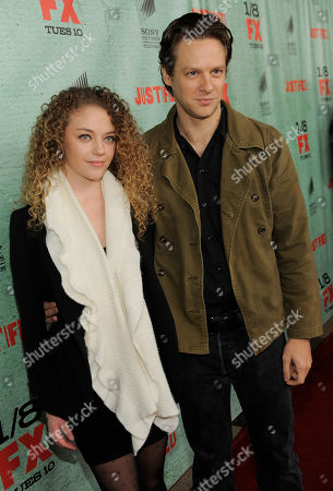 "Jacob Pitts, right, a cast member in the FX series ""Justified,"" poses with his girlfriend Shelby Malone at the show's fourth season premiere screening at Paramount Theatre, in Los Angeles"