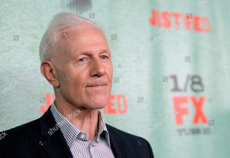 "Stock Photo of Justified"" cast member Raymond Barry poses at the show's fourth season premiere screening at Paramount Theatre, in Los Angeles"