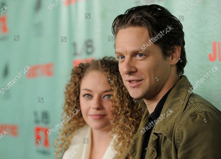 "Stock Photo of Jacob Pitts, right, a cast member in the FX series ""Justified,"" poses with his girlfriend Shelby Malone at the show's fourth season premiere screening at Paramount Theatre, in Los Angeles"