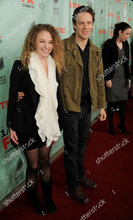 "Stock Image of Jacob Pitts, right, a cast member in the FX series ""Justified,"" poses with his girlfriend Shelby Malone at the show's fourth season premiere screening at Paramount Theatre, in Los Angeles"