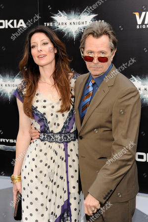"""Actor Gary Oldman and wife Alexandra Edenborough arrive to the world premiere of """"The Dark Knight Rises"""", in New York"""