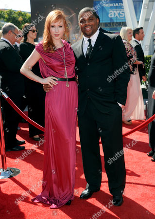 Mary Kate Wiles, left, and guest arrive at the Primetime Creative Arts Emmy Awards at the Nokia Theatre L.A. Live, in Los Angeles