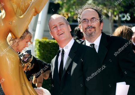 Eric Slovin, left, and Robert Smigel arrive at the Primetime Creative Arts Emmy Awards at the Nokia Theatre L.A. Live, in Los Angeles