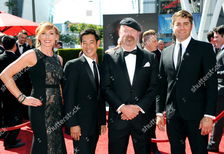 From left, Kari Byron, Grant Imahara, Jamie Hyneman, and Tory Belleci arrive at the Primetime Creative Arts Emmy Awards at the Nokia Theatre L.A. Live, in Los Angeles