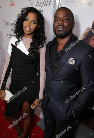 """Brandee Evans and Christian Weber attend the premiere for Relativity Studios' and BET Studios' """"Beyond the Lights"""" held at the Arclight Hollywood theater, in Los Angeles"""