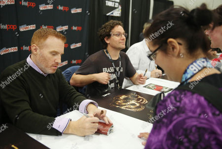 """Jon Steinberg, left, and Robert Levine, from the STARZ Original Series """"Black Sails"""", are seen during an autograph signing at New York Comic Con on in New York"""