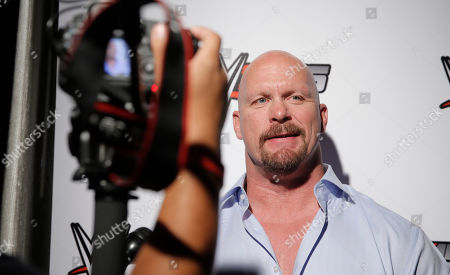 WWE Hall of Famer Stone Cold Steve Austin chats with media about WWE 2K15 at the SummerSlam Confidential Panel at Club Nokia, on in Los Angeles