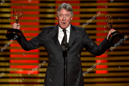 """Alan Silvestri accepts the award for outstanding main title theme music for his work on """"Cosmos: A Spacetime Odyssey"""" at the Television Academy's Creative Arts Emmy Awards at the Nokia Theater L.A. LIVE, in Los Angeles"""