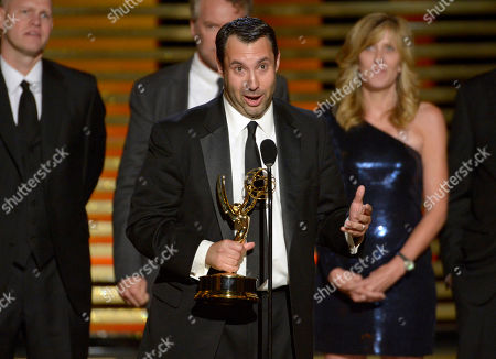 """John Dahl, center, accepts the award for outstanding special class - short-format nonfiction programs for """"30 for 30 Shorts"""" at the Television Academy's Creative Arts Emmy Awards at the Nokia Theater L.A. LIVE, in Los Angeles. Looking on from back left Dan Silver, Tate Donovan and Maura Mandt"""