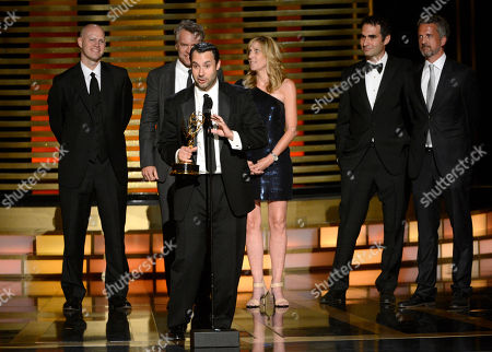 """Connor Schell accepts the award for outstanding special class - short-format nonfiction programs for """"30 for 30 Shorts"""" at the Television Academy's Creative Arts Emmy Awards at the Nokia Theater L.A. LIVE, in Los Angeles. Looking on from back left Dan Silver, Tate Donovan, Maura Mandt, Bill Simmons and John Dahl"""